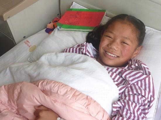 图3:藏族儿童康卓小朋友纯真的笑容
