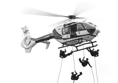 □特警队员在演练中从空中索降