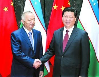 5月20日,国家主席习近平在上海会见乌兹别克斯坦总统卡里莫夫。 新华社记者 庞兴雷 摄