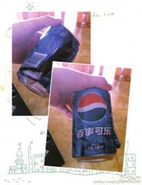 □新闻晨报 肖 允 摄 小图为爆瓶的可乐。