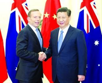 国家主席习近平11日在人民大会堂会见澳大利亚总理阿博特 /新华社
